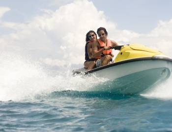 couple on jet skis