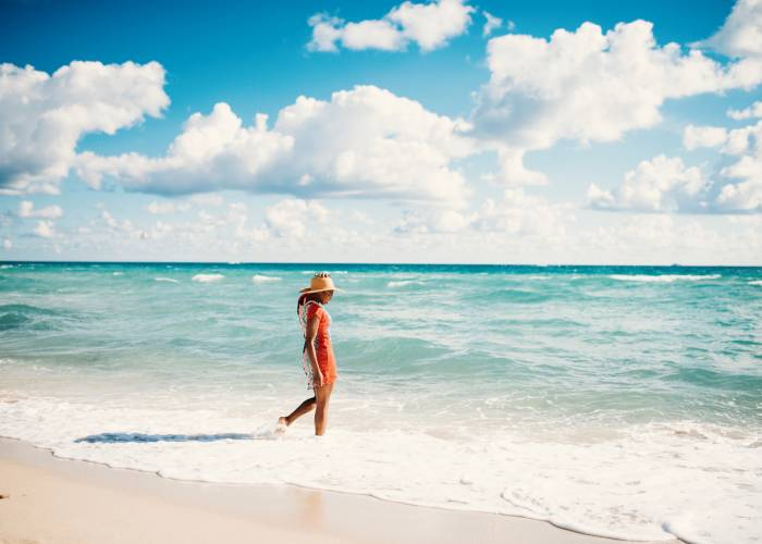 woman walking in water on panama city beach